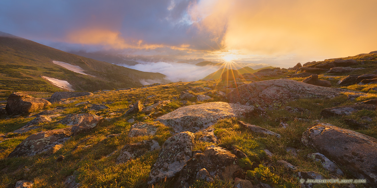 A photograph of a beautiful sunrise on the tundra landscape of Rocky Mountain National Park in Colorado. - Colorado Picture